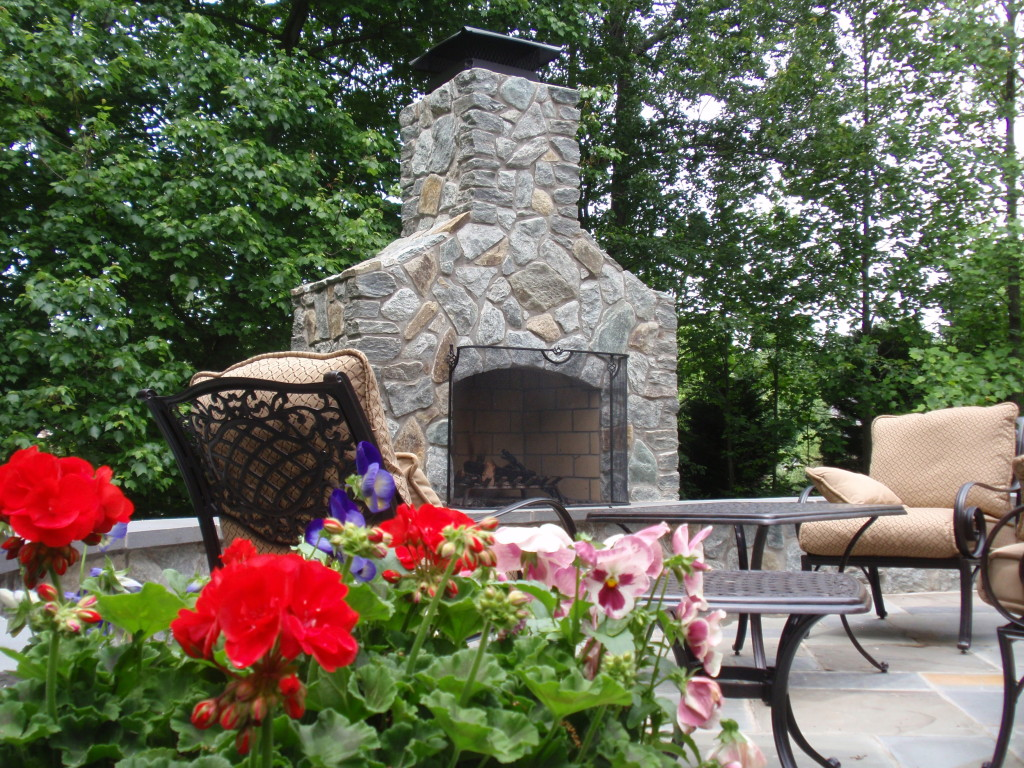 A custom made fireplace will allow you to enjoy your backyard landscape year-long.
