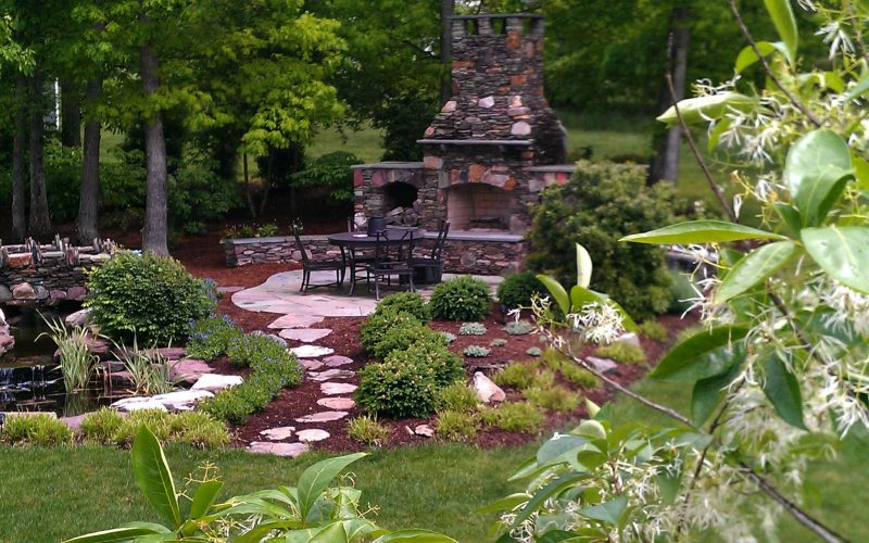 Add hardscaping and a fireplace to your backyard landscaping